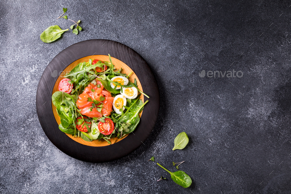 Salmon Salad with Vitamins in vegetables and herbs - Stock Photo - Images