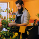 The bearded stylish flower seller holds pink roses in a market s - PhotoDune Item for Sale