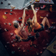 Male and female climbing on an indoor climbing wall. - PhotoDune Item for Sale