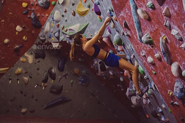 Female climber. Extreme indoor climbing. - Stock Photo - Images