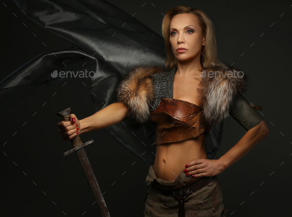 Middle age woman in armors - Stock Photo - Images