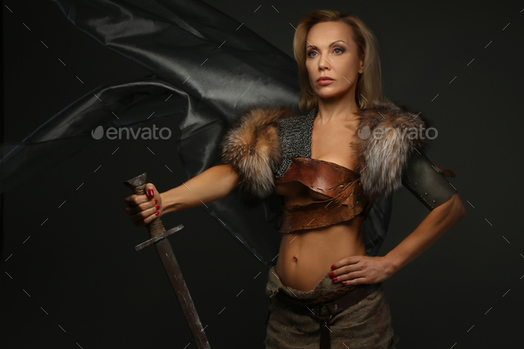 Middle age woman with sword - Stock Photo - Images