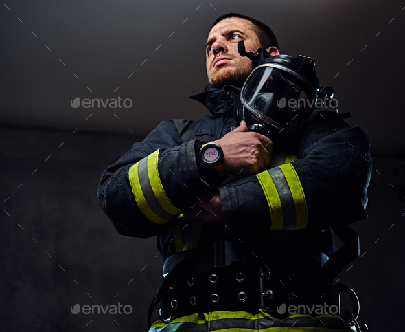 Studio portrait of a male dressed in a firefighter uniform. - Stock Photo - Images