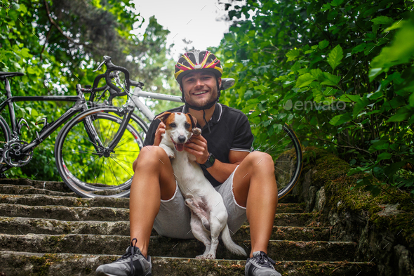 Male posing with his russel dog on stairs. - Stock Photo - Images