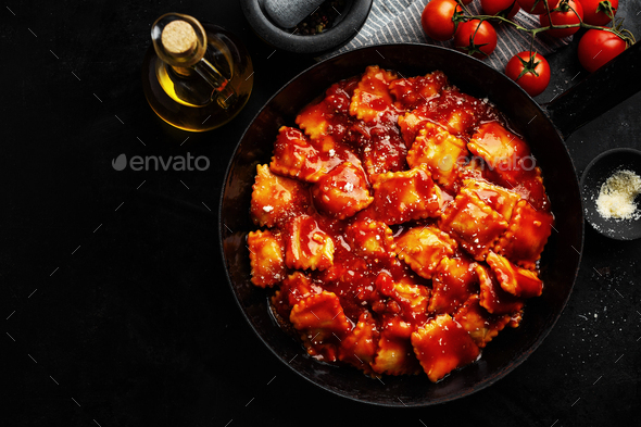 Fresh cooked italian ravioli with sauce - Stock Photo - Images