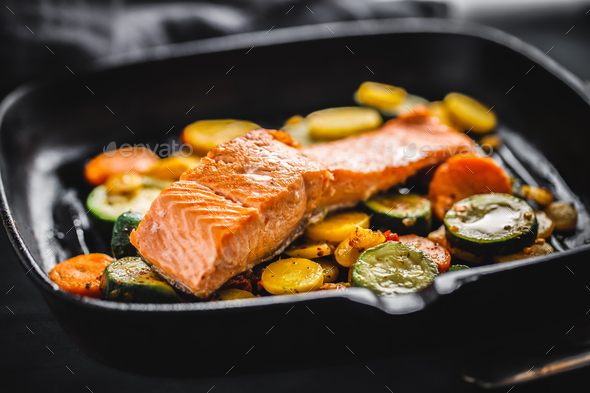 Grilled salmon with vegetables on pan - Stock Photo - Images