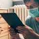 Man using digital tablet in self-isolation quarantine - PhotoDune Item for Sale