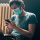 Man using laptop computer and smartphone in self-isolation quarantine - PhotoDune Item for Sale