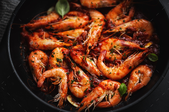 Fried shrimps with spices on pan - Stock Photo - Images