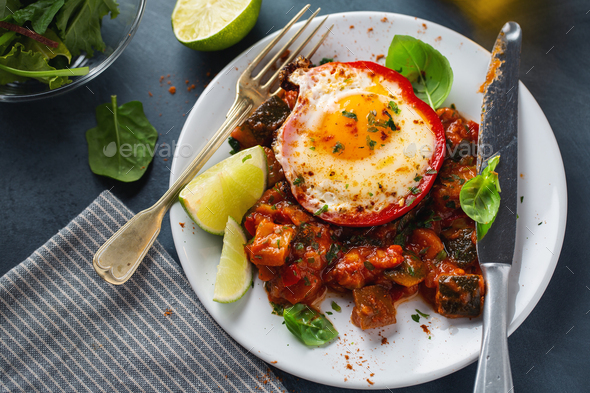 Fried egg with vegetables on plate - Stock Photo - Images