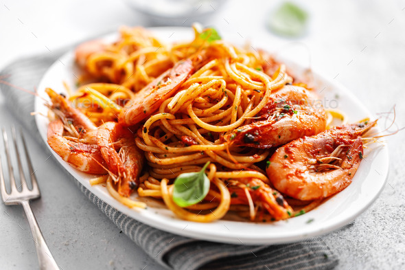 Pasta spaghetti with tomato sauce and shrimps - Stock Photo - Images