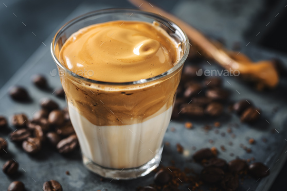 Dalgona coffee with whipped foam in cup - Stock Photo - Images