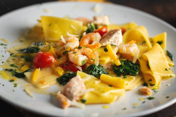 Pasty with shrimps and vegetables on plate - Stock Photo - Images