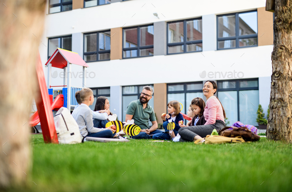 Group of cheerful children learning outdoors at school after covid-19 quarantine and lockdown - Stock Photo - Images