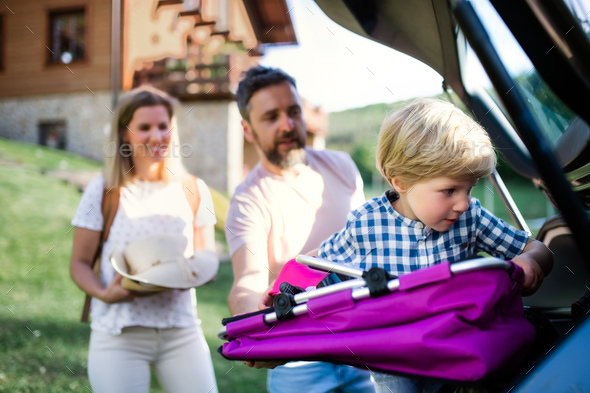 Family with small child going on trip in countryside - Stock Photo - Images