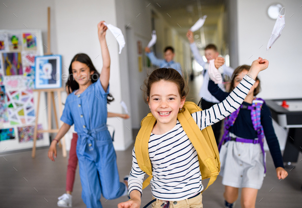 Group of cheerful children going home from school after covid-19 quarantine and lockdown - Stock Photo - Images