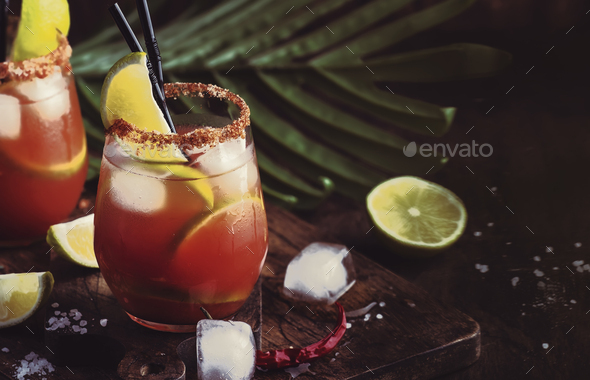 Mexican inspired bloody mary alcoholic cocktail with beer, lime juice, tomato juice - Stock Photo - Images