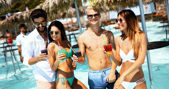Group of happy friends having fun on tropical beach, summer holiday party - Stock Photo - Images