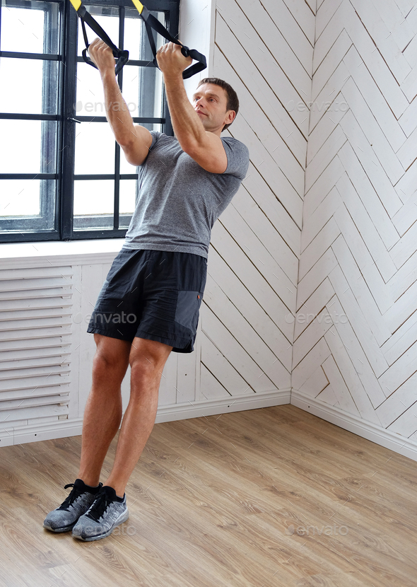 Middle age man doing workouts. - Stock Photo - Images