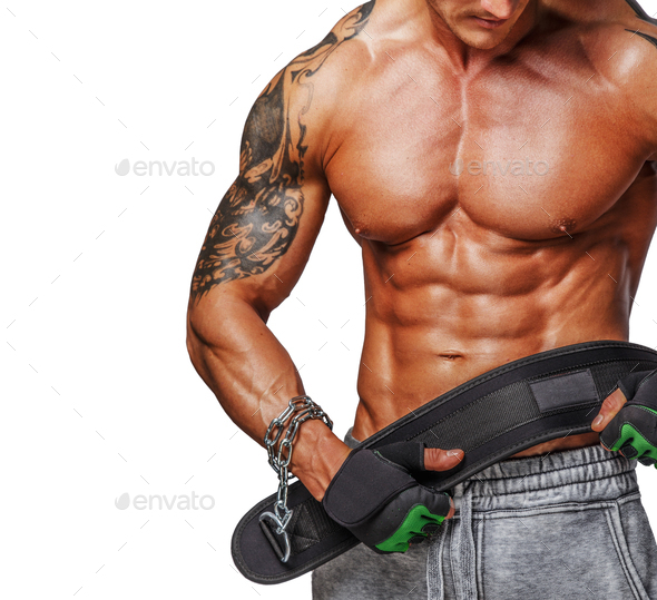 Muscular male holding power weist - Stock Photo - Images