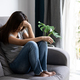 Lonely young asian woman felling depressed and stressed in living room - PhotoDune Item for Sale