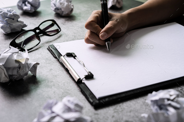 Hand writing on file folder with crumpled paper balls on desk office, Creativity problems concept - Stock Photo - Images