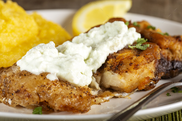 Fried fish with polenta and garlic sauce - Stock Photo - Images