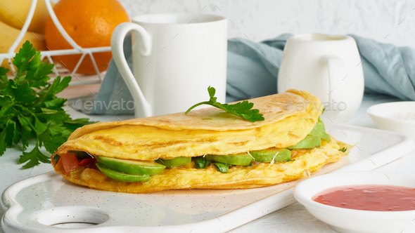 Trendy breakfast with quesadilla and eggs, trending food with omelet, cheese - Stock Photo - Images