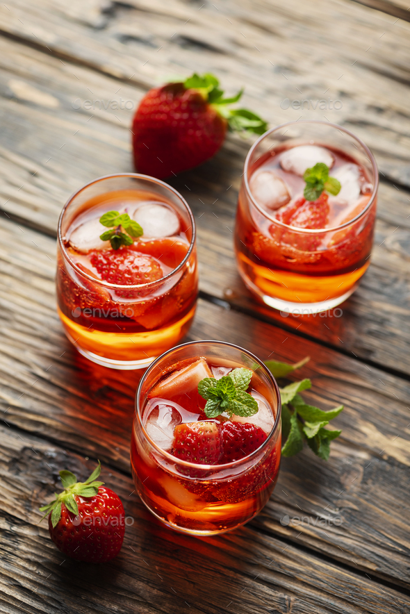 Fresh summer cocktail with ice, strawberry and mint - Stock Photo - Images