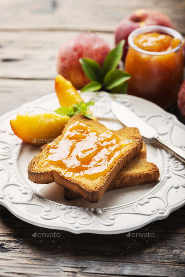 Healthy breakfast with toast and peach jam - Stock Photo - Images