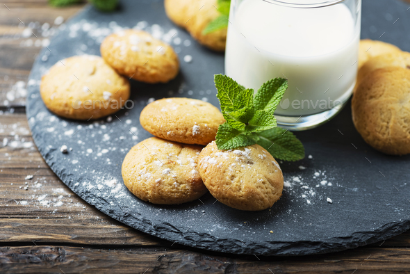 Homemeade cookies with milk on the wooden table - Stock Photo - Images