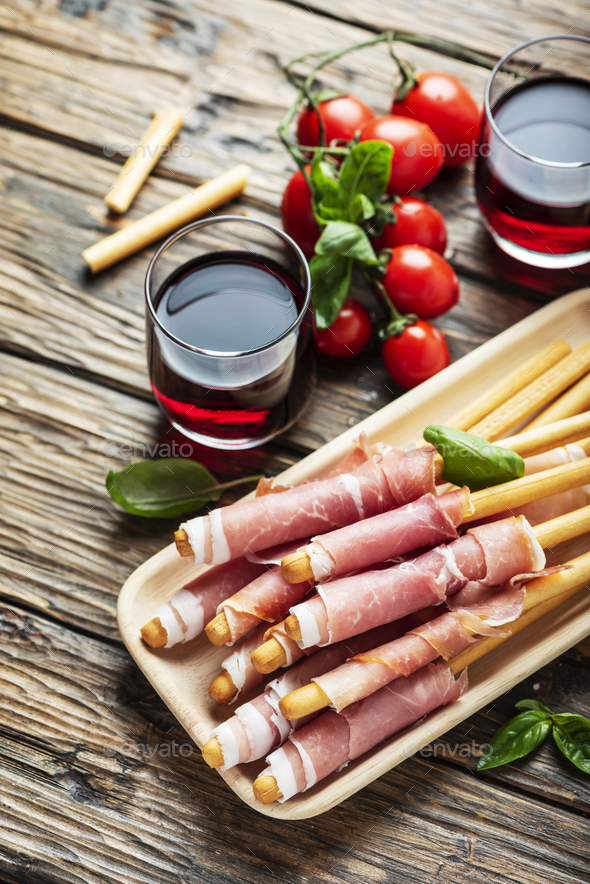 Italian antipasto with brad sticks and pork ham - Stock Photo - Images