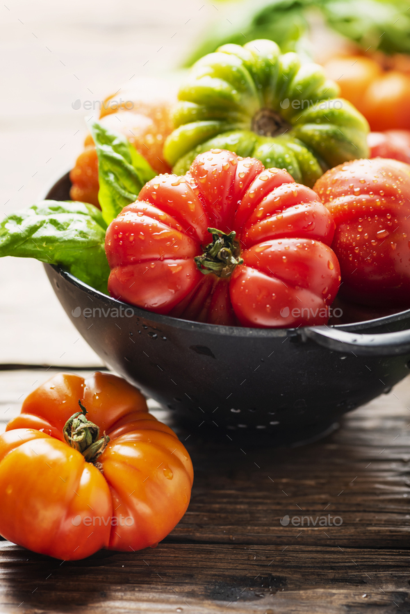 Mix of red, orange and green tomatoes - Stock Photo - Images