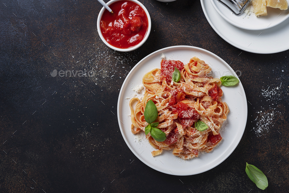Traditional italian pasta with tomato, basil and parmesan - Stock Photo - Images