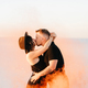 guy and a girl in black clothes hug and run on the white sand - PhotoDune Item for Sale