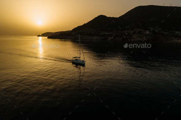 Aerial view of yacht in the sea with beautiful sunrise - Stock Photo - Images
