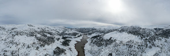 Aerial view of winter lake in snowy mountains - Stock Photo - Images