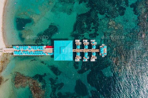 Aerial view of resort pierce in transparent sea water with rocks - Stock Photo - Images