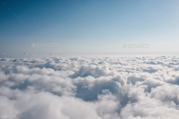 Aerial view of sky above clouds - Stock Photo - Images