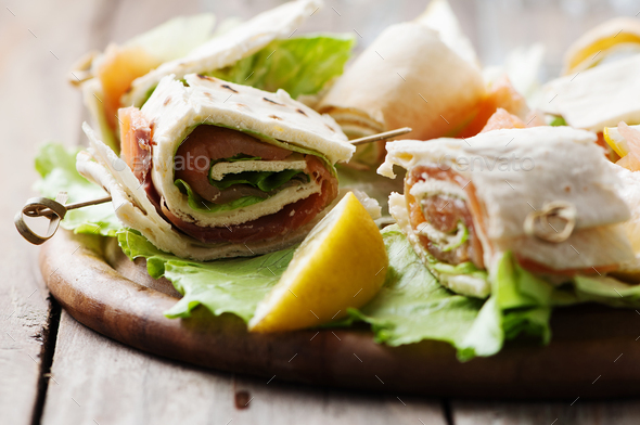 Bread rolls with salmon and salad - Stock Photo - Images