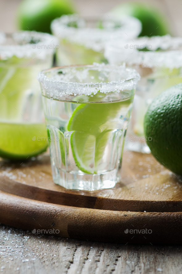 Silver mexican tequila with lime - Stock Photo - Images