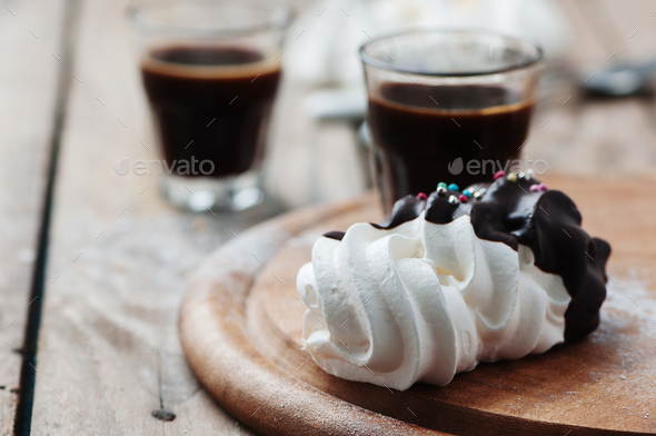 Sweet meringue with cup of italian coffee - Stock Photo - Images