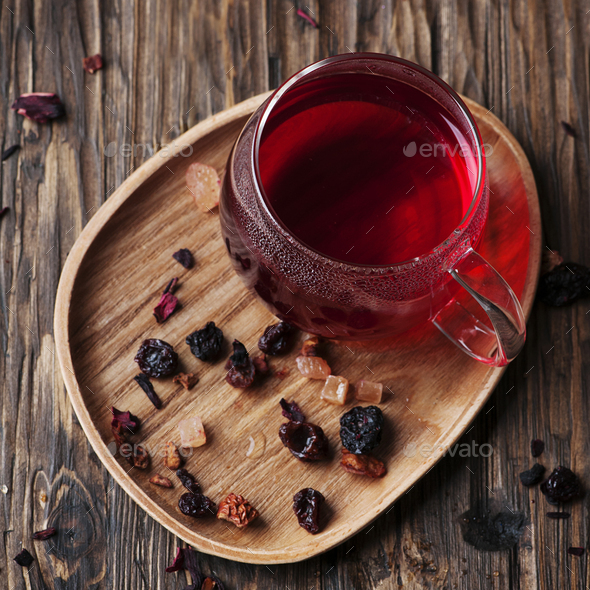 Red hot tea on the wooden table - Stock Photo - Images