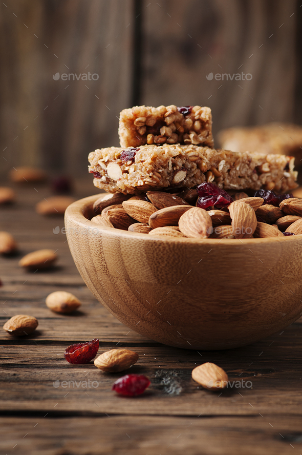 Cereal bar with almond and berry on thw wooden table - Stock Photo - Images