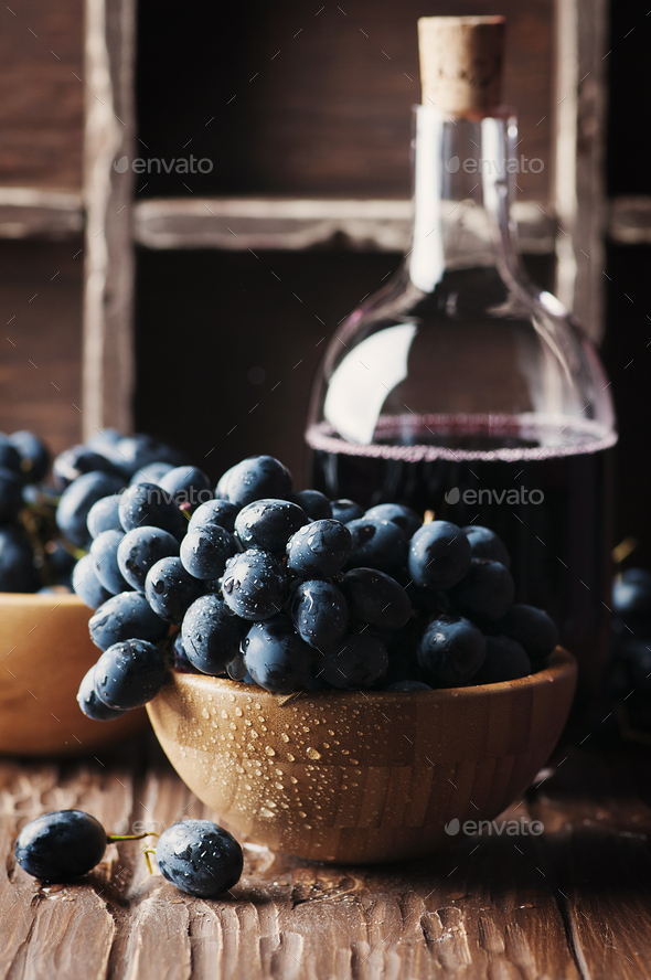 Fresh grape and red wine on the vintage table - Stock Photo - Images
