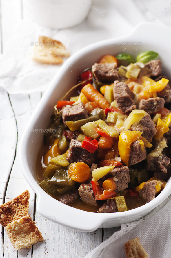 Stewed meat with carrot, paprika and rosemary - Stock Photo - Images
