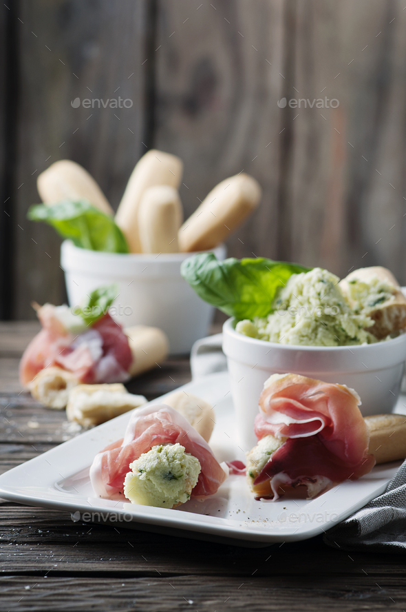 Italian grissini with cream cheese and prosciutto - Stock Photo - Images