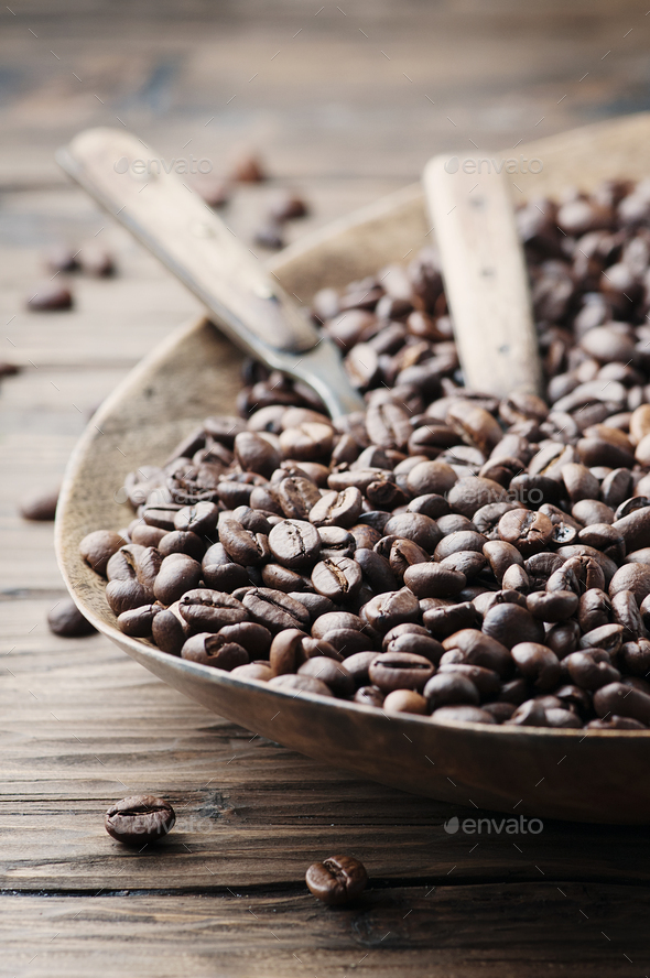 Raw coffee beans on the wooden table - Stock Photo - Images