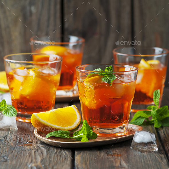 Glass of aperol with ice, orange and mint - Stock Photo - Images