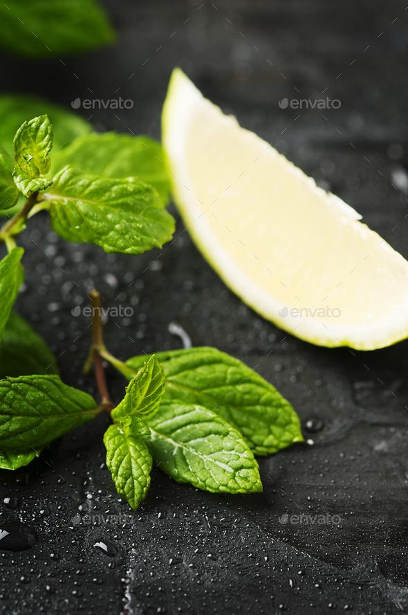 Fresh lemon anf green mint on the black table - Stock Photo - Images